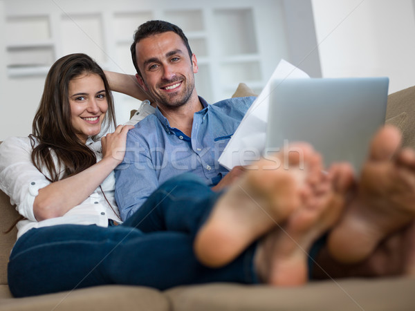 relaxed young couple working on laptop computer at home Stock photo © dotshock
