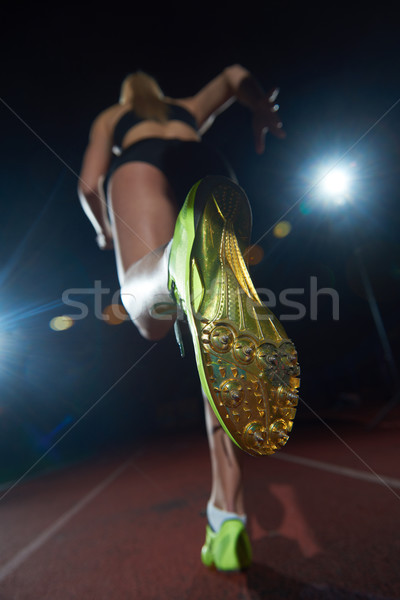 woman  sprinter leaving starting blocks Stock photo © dotshock