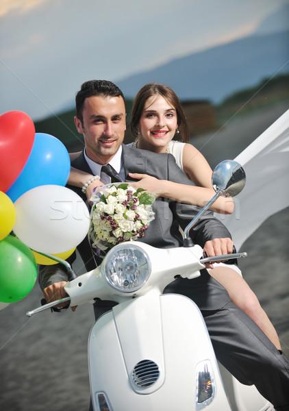 Friss házasok pár tengerpart fehér moped esküvő Stock fotó © dotshock