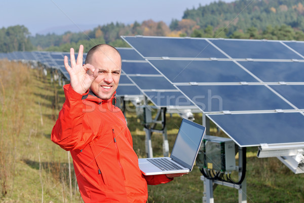 engineer using laptop at solar panels plant field Stock photo © dotshock