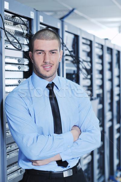 young it engineer in datacenter server room Stock photo © dotshock
