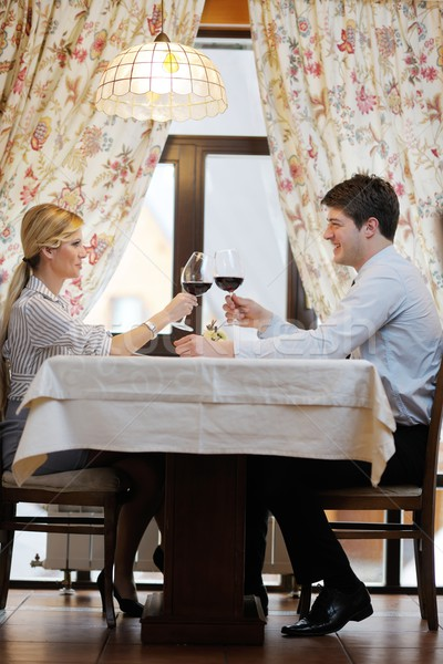 young couple having dinner at a restaurant Stock photo © dotshock