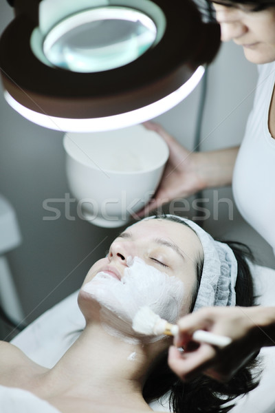 woman with facial mask in cosmetic studio Stock photo © dotshock
