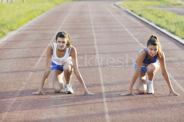 Iki kızlar çalışma yarış pisti genç kız Stok fotoğraf © dotshock