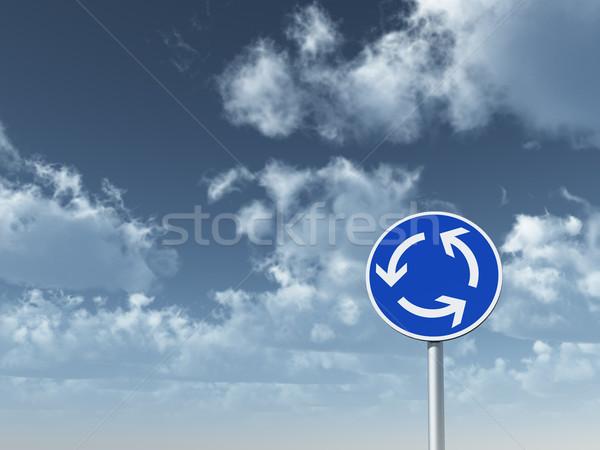 Cirkel verkeer rotonde bewolkt blauwe hemel Stockfoto © drizzd