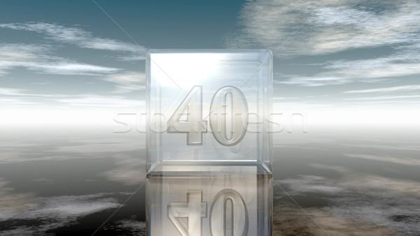 Numer czterdzieści szkła kostki mętny niebo Zdjęcia stock © drizzd