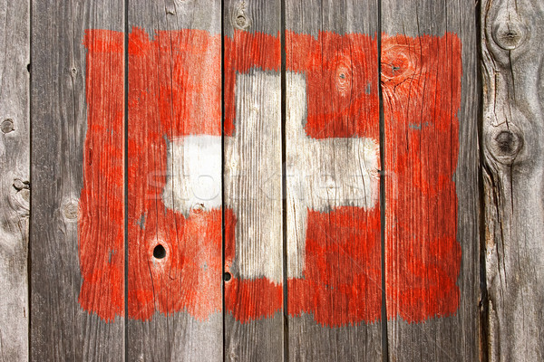 swiss colors on old wooden wound Stock photo © drizzd
