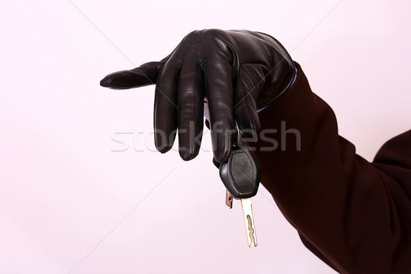Gloved hand holding car keys Stock photo © dukibu