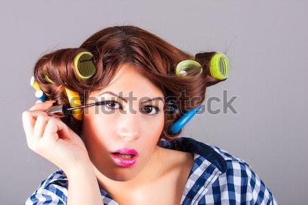 Girl applying make up Stock photo © dukibu