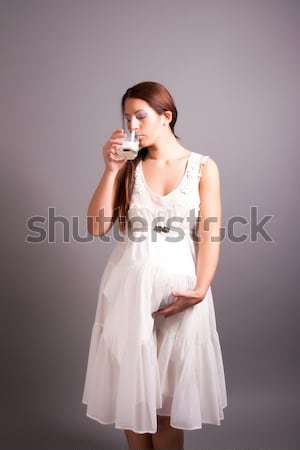 Hamile kadın içme süt portre kız gülümseme Stok fotoğraf © dukibu