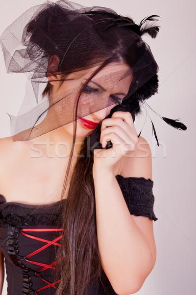 Crying black widow woman Stock photo © dukibu