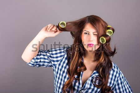 Attractive girl with curlers Stock photo © dukibu