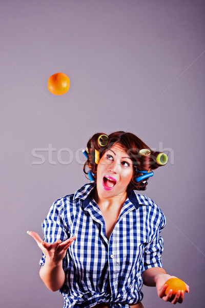 Young housewife with oranges Stock photo © dukibu