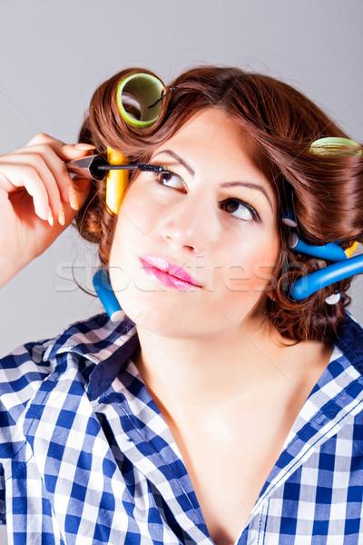 Attractive woman applying eyeliner Stock photo © dukibu