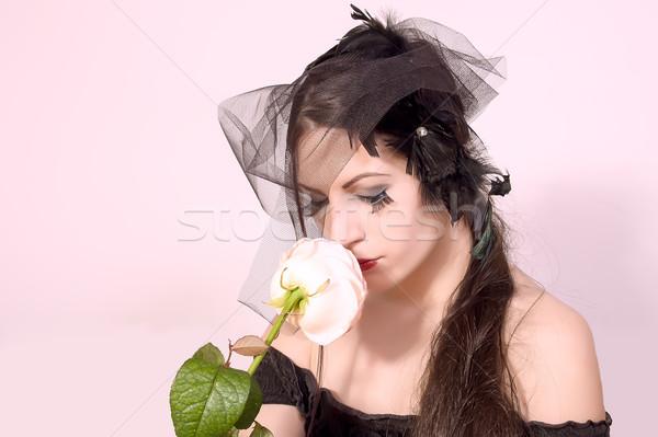 Black widow woman holding flower Stock photo © dukibu