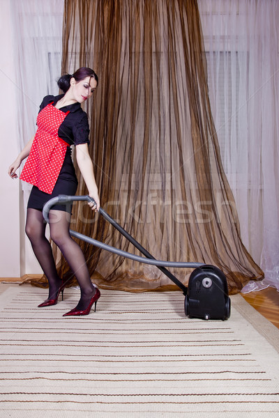 Housewife doing housework with vacuum cleaner Stock photo © dukibu