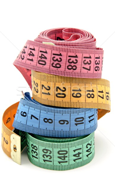 Tape measure on white background Stock photo © dulsita