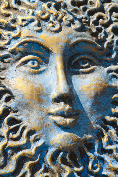 Blue and gold weathered sun face Stock photo © duoduo