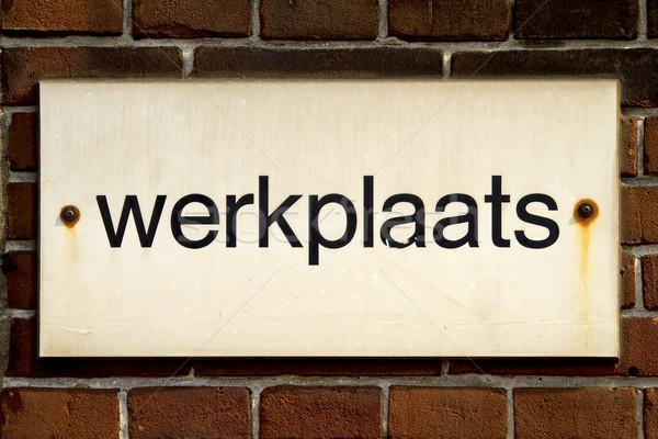 Sign board on brick wall Stock photo © duoduo