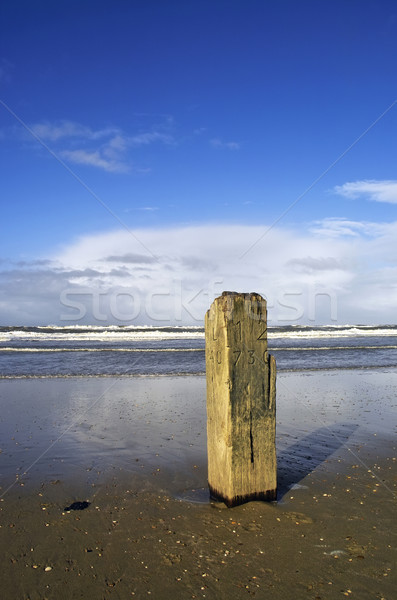 Wooden pole with the tide going out Stock photo © duoduo