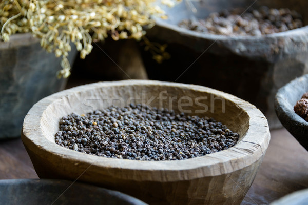 Black pepper in a wooden bowl Stock photo © dutourdumonde