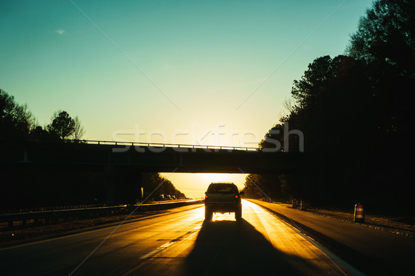 Stock photo: Car driving into the sunset