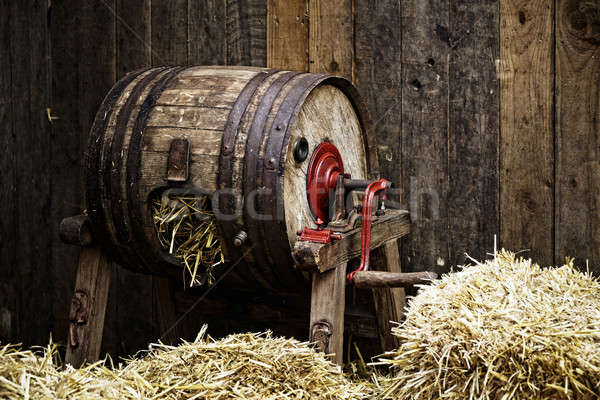 Barrel-type butter churnfilled with straw Stock photo © dutourdumonde