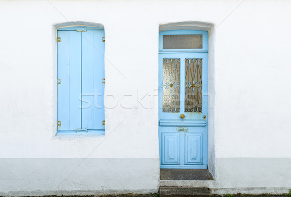 House facade with pastel blue blinds and door Stock photo © dutourdumonde