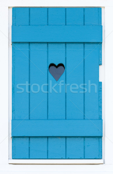 Wooden shutter with a carved heart  Stock photo © dutourdumonde