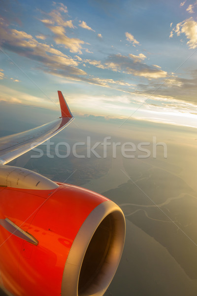 Airliner in flight at sunset Stock photo © dutourdumonde