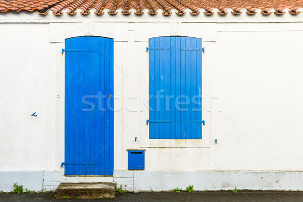 House facade with blue blinds and door Stock photo © dutourdumonde