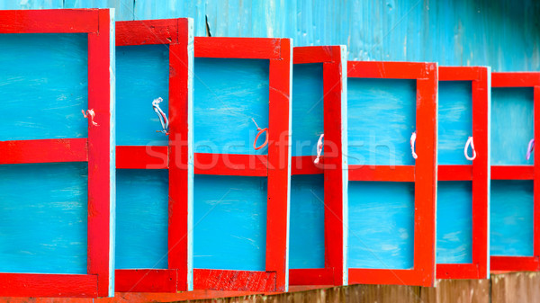 Red and blue wooden shutters Stock photo © dutourdumonde