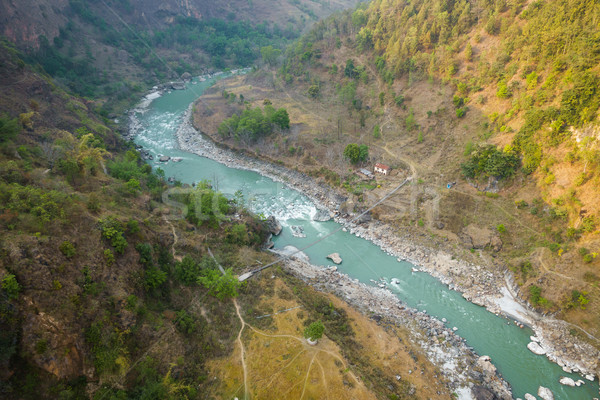 Aerial view of small suspension bridge in Nepal Stock photo © dutourdumonde