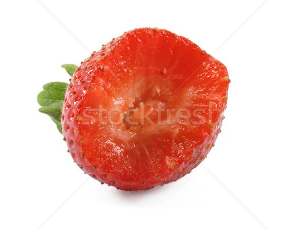 Bitten strawberry on white background Stock photo © dutourdumonde