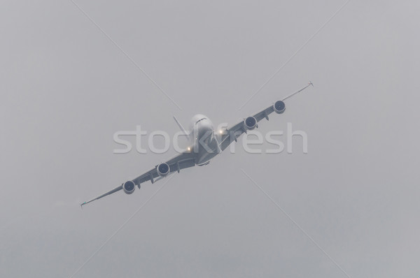 Passenger airliner in bad weather Stock photo © dutourdumonde