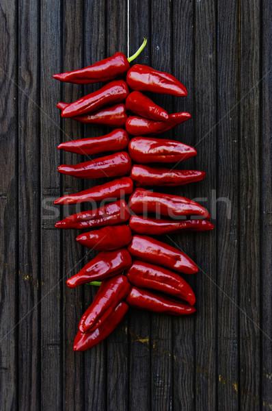 Paprikák akasztás ajtó étel háttér szín Stock fotó © dutourdumonde