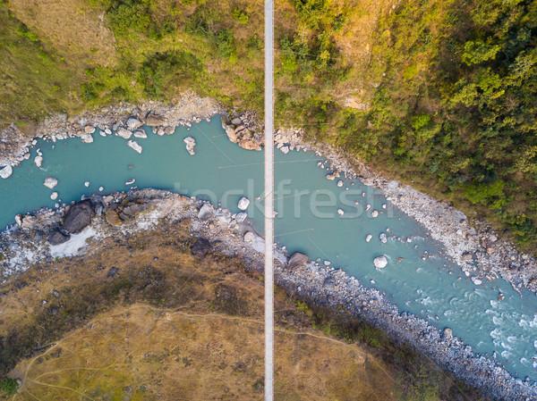 Vista puente colgante Nepal río agua construcción Foto stock © dutourdumonde