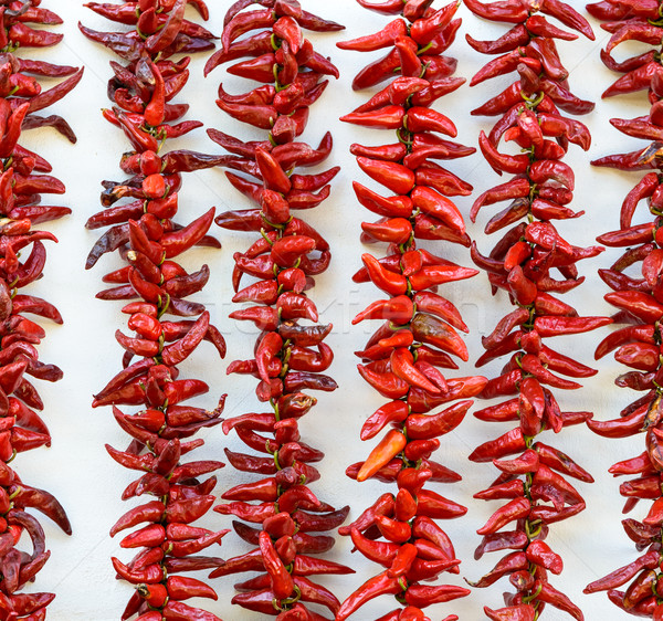 Strings of Espelette peppers drying Stock photo © dutourdumonde