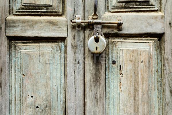 Stock photo: Wooden door shut with a lock