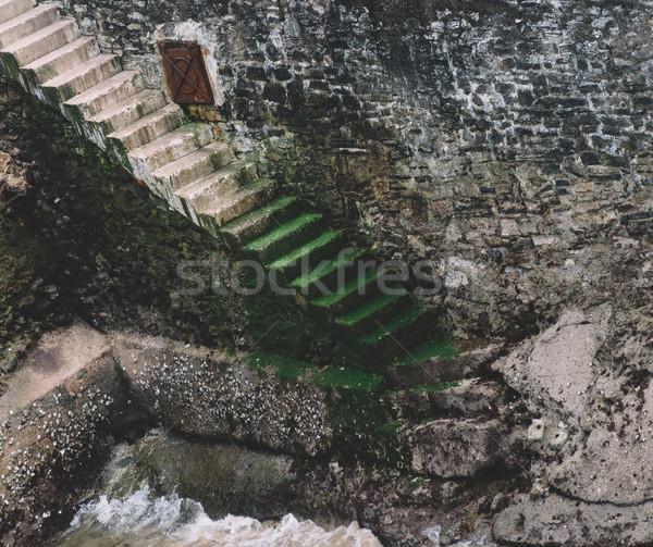 Beton merdiven taş duvar deniz seviye Stok fotoğraf © dutourdumonde