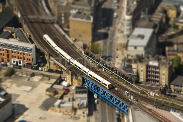 Train on a bridge in London, tilt-shift effect Stock photo © dutourdumonde