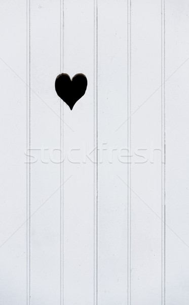 Stock photo: Wooden door with a carved heart