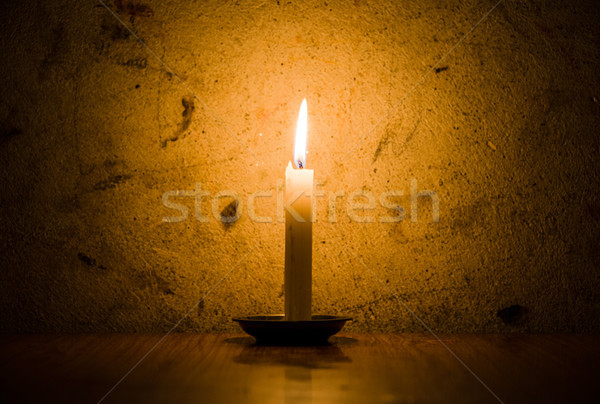 Candle burning, grungy wall background Stock photo © dutourdumonde