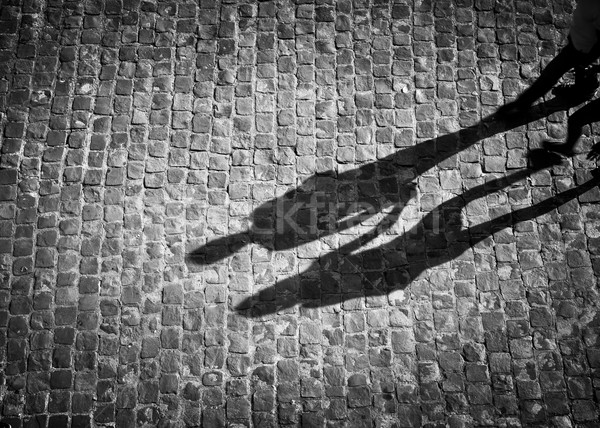 Shadow of couple holding hands Stock photo © dutourdumonde