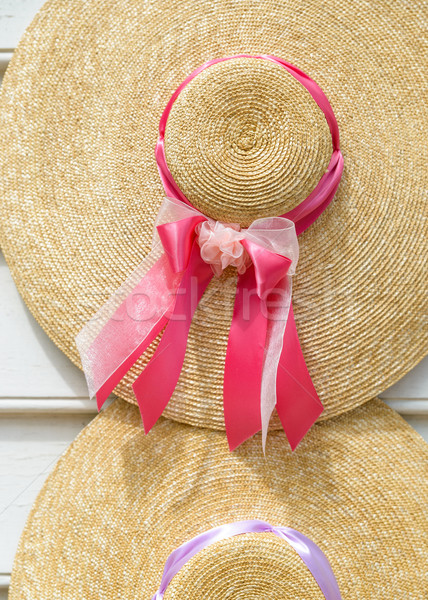 Straw hats with ribbons Stock photo © dutourdumonde