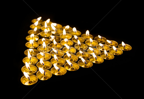 Triangle made of candles Stock photo © dutourdumonde
