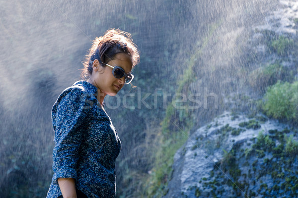 Nepalese woman standing next to a waterfall Stock photo © dutourdumonde