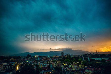 Onweersbui zonsondergang vallei huis stad landschap Stockfoto © dutourdumonde
