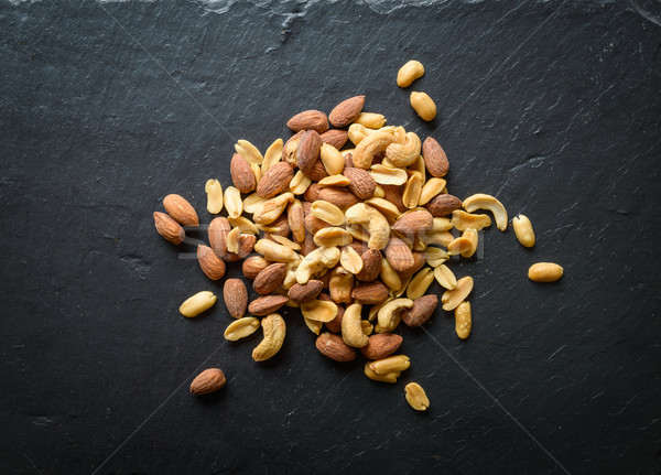 Nuts on a slate Stock photo © dutourdumonde