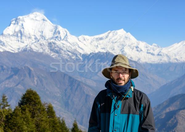 молодым человеком Непал Hat снега гор Сток-фото © dutourdumonde